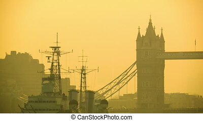 Morning traffic on the Tower Bridge - Two iconic symbol of...