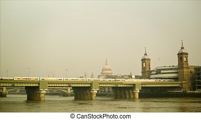 Train passing to Cannon Street station. In the background...