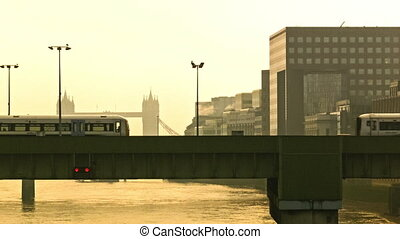 Trains are approaching on a railway bridge in the earls...