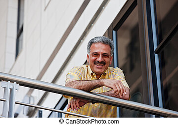 businessman - baby boomers Iranian businessman with yellow...