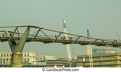 Close up of Millennium Bridge - Catch the relaxed moment of...