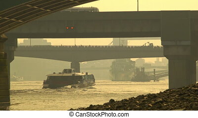 Boat passing under the railway - Busy morning shot on and...