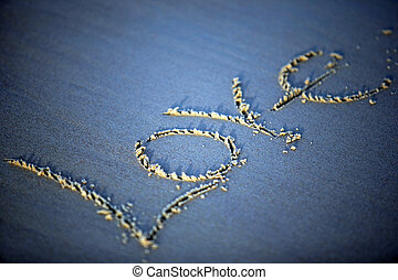 "Necessary word - The word ""love"" is written by someone on..."