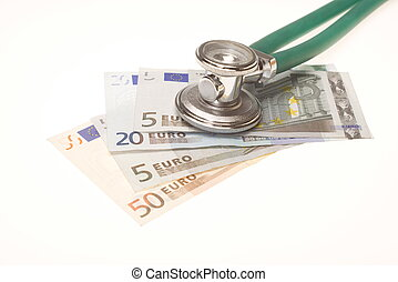 Stethoscope on the top of the money. Selective focus on...