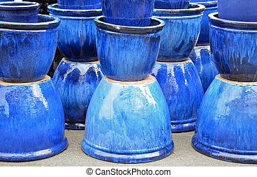 Blue glazed ceramic pots on display
