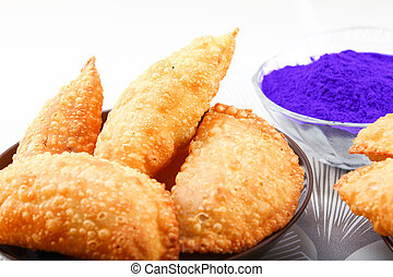 holi color with gujiya - holi color in bowl with gujia