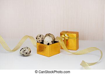 golden box with Easter eggs and ribbon.