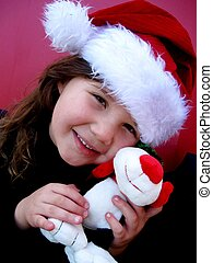 Little girl with stuffed animal - Pretty girl at Christmas...