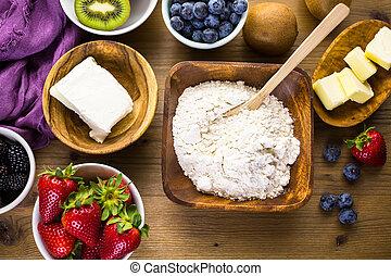Ingredients for preparing fresh fruit tart.