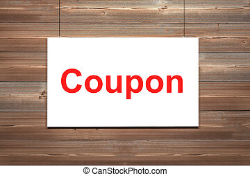 white canvas on wooden wall torn to reveal coupon - white...