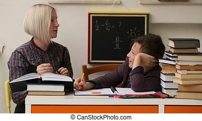 Student doing homework with the help of a tutor.