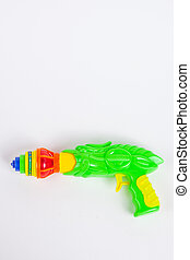 toy gun with spinning top on white paper background