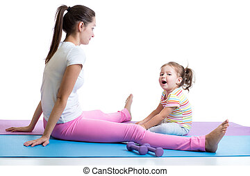 Mother practices fitness with her kid isolated