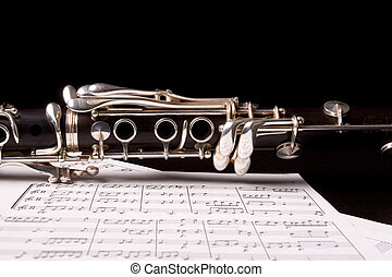 clarinet - Photograph of a clarinet isolated over sheet...