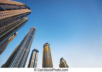 high beautiful skyscrapers on blue sky background