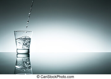 Glas of fresh water - A glas of fresh water, with a bottle