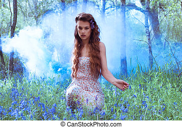 Artistic portrait of a girl in a bluebell forest - Artistic...