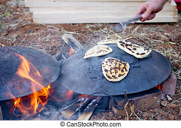 Pita bread baking on a Saj or Tava on Lag Baomer