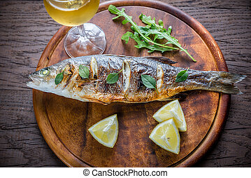 Grilled seabass on the wooden board