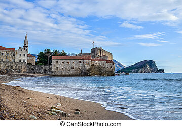 Montenegro Budva beach near old town wall and fortress in...