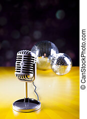 Microphone with disco balls, music saturated concept