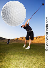 Golf drive - A golfer driving the ball down the fairway...