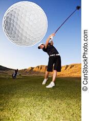 Golf drive - A golfer driving the ball down the fairway...
