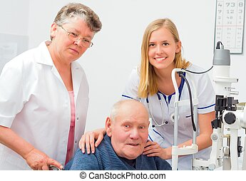 Old Age's Presbyopia - Old man with nurse and doctor at an...