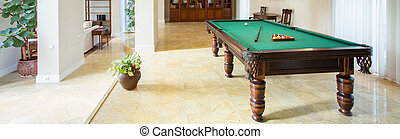 Billiard table in living room in luxury apartment, panorama