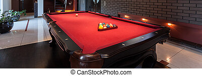 Red pool table - Panoramic view of red pool table in a...