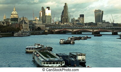 Boats on the Thames and The City of London. View from the...