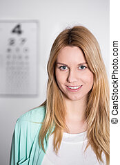 Young female optician - Portrait of young pretty female...