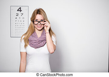 Woman at optician's office - Young beautiful woman with...