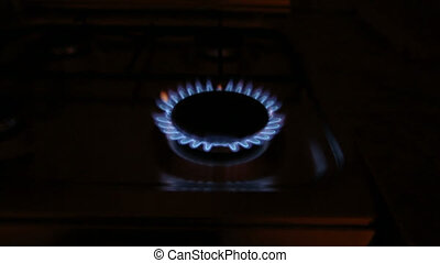 Gas burner zoom - A natural gas oven flames in dark,...