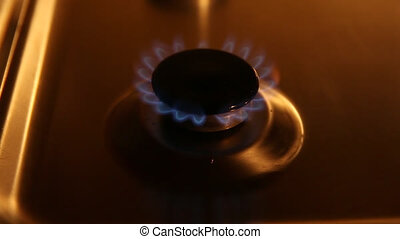 Small gas burner on-off - A small gas burner with blue...