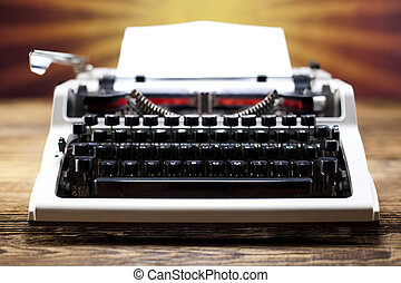 Typewriter and a blank sheet of paper