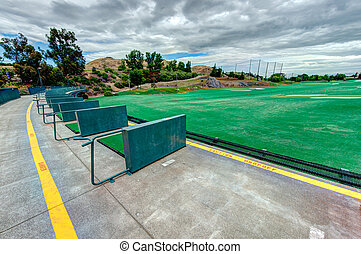 Golf driving range stations above ground - Top level of a...