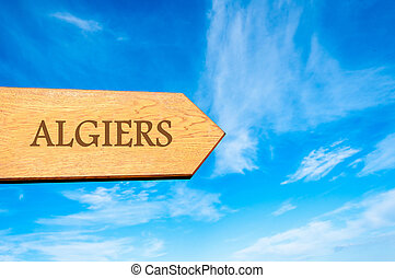 destination ALGIERS, ALGERIA - Wooden arrow sign pointing...