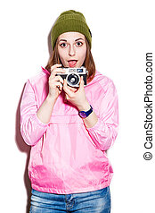 Cheerful attractive girl with camera