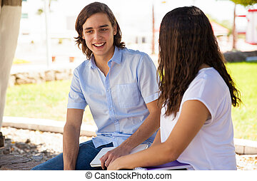 Attractive guy talking to a girl