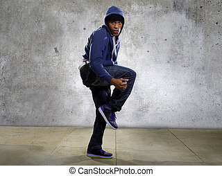 Hooded Urban Dancer - young black male dancing hip hop style...