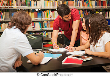College friends studying together - Male college student...
