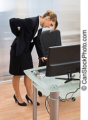 Young Businesswoman Having Backpain - Young Businesswoman...