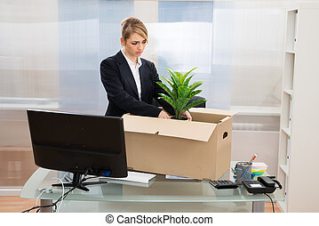 Businesswoman Packing Belongings In Box - Unhappy...