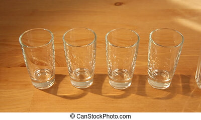 Hovering over small and big glasses - Sliding over a row of...