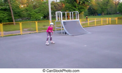 portrait of a sportive child inline skating - Outdoor...