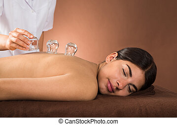 Young Woman Getting Cupping Treatment - Young Female Lying...