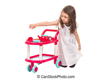 Girl playing with toy pram