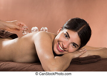 Smiling Woman Receiving Cupping Therapy - Acupuncture...