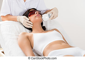 Beautician Giving Epilation Laser Treatment - Close-up Of...